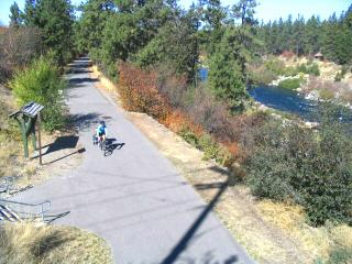 Cycling the paved Centennial Trail beside the Spokane River